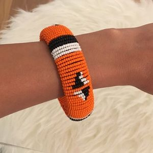 Jewelry - BEADED ARM BAND FROM JAMAICA NWOT